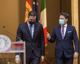 Spain's Prime Minister Pedro Sanchez, left, and his Italian counterpart Giuseppe Conte arrive at a press conference at Chigi Palace government's office in Rome, Tuesday, Oct. 20, 2020. (AP Photo/Domenico Stinellis)