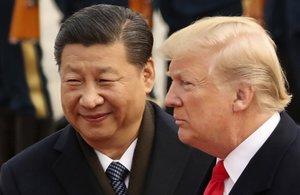 Xi Jinping y Donald Trump, en un encuentro en Pekín, en noviembre del 2017.