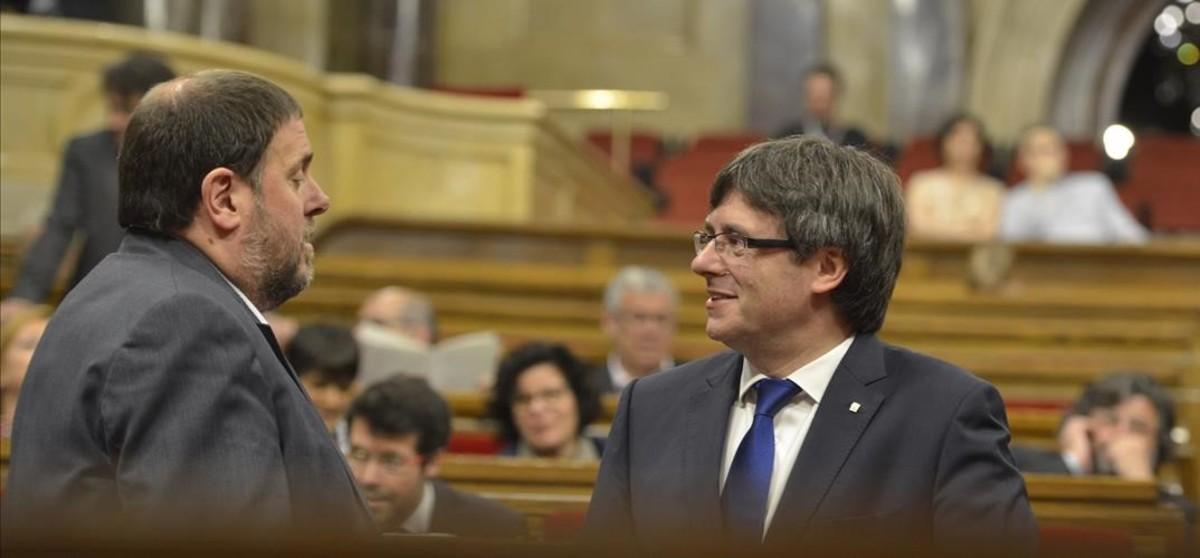 Carles Puigdemont iOriol Junqueras.