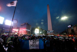 Fans gather in front of the Obelisk in support of Argentinas player Lionel Messi, who recently announced his retirement from international soccer, and to ask him to come back to the national squad in Buenos Aires, Argentina, July 2, 2016. The Argentine flag at the bottom reads I believe in Messi. REUTERS/Marcos Brindicci