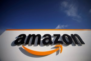 FILE PHOTO: The logo of Amazon is seen at the company logistics center in Boves, France, November 5, 2019. REUTERS/Pascal Rossignol/File Photo