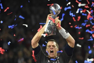 Tom Brady #12 of the New England Patriots holds the Vince Lombardi Trophy after defeating the Atlanta Falcons 34-28 in overtime during Super Bowl 51 at NRG Stadium on February 5, 2017 in Houston, Texas.
