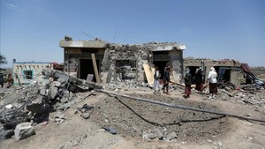 zentauroepp39776224 people stand at the site of saudi led air strikes in arhab a170823131515