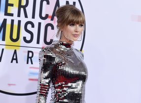 Taylor Swift arrives at the American Music Awards at the Microsoft Theater in Los Angeles  Swift has donated  15 500 to a GoFundMe account of a fan whose family is struggling with medical bills   Photo by Jordan Strauss Invision AP  File