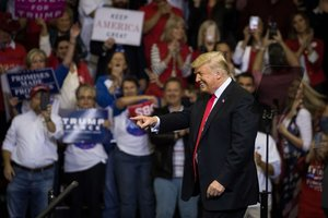 HOUSTON, TX - OCTOBER 22: U.S. President Donald Trump takes the stage for a rally in support of Sen. Ted Cruz (R-TX) on October 22, 2018 at the Toyota Center in Houston, Texas. Cruz, the incumbent, is seeking Senate re-election in a high-profile race against Democratic challenger Beto ORourke. Loren Elliott/Getty Images/AFP
