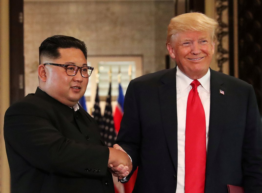 U.S. President Donald Trump and North Korea's leader Kim Jong Un shake hands after signing documents during a summit at the Capella Hotel on the resort island of Sentosa, Singapore.  REUTERS/Jonathan Ernst/File Photo