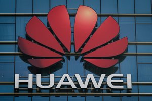 The Huawei logo stands on a Huawei office building in Dongguan in China s southern Guangdong province- British Defence Secretary Gavin Williamson has warned of his  very deep concerns  about Chinese technology giant Huawei being involved in the use of 5G on Britain s mobile network   The Times reported   Photo by Nicolas ASFOURI   AFP