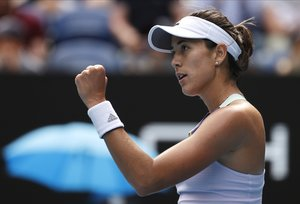 Spain's Garbine Muguruza reacts after defeating Kiki Bertens of the Netherlands in their fourth round singles match at the Australian Open tennis championship in Melbourne, Australia, Monday, Jan. 27, 2020. (AP Photo/Andy Wong)