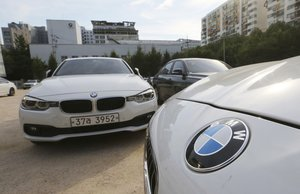 BMW cars are parked for an emergency safety check at the playground of an elementary school near a BMW service center in SeoulSouth Korea.AP Photo Ahn Young-joonFile