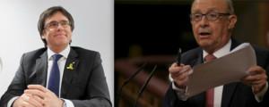 A la izquierda, Carles Puigdemont, expresident de la Generalitat. A la derecha, Cristóbal Montoro, ministro de Hacienda.