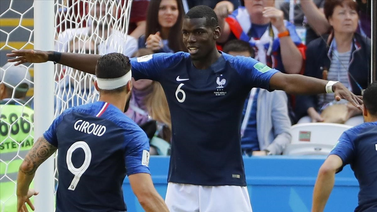 Pogba celebra el gol del triunfo junto a Giroud.
