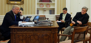 Trump, seated with Flynn and Bannon, speaks by phone with Turnbull in the Oval Office at the White House