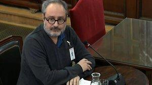 El exdiputado de la CUP Antonio Baños, citado como testigo, antes de abandonar la sala.