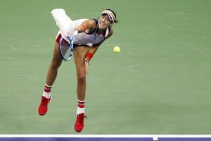 Garbine Muguruza, of Spain, serves against Petra Kvitova, of the Czech Republic, during the fourth round of the U.S. Open tennis tournament, Sunday, Sept. 3, 2017. (AP Photo/Adam Hunger)