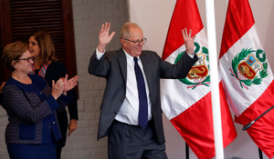 Peruvian presidential candidate Pedro Pablo Kuczynski, accompanied by his wife Nancy Lange (L), gives a speech to the press after Perus electoral office ONPE said that he won more votes than Keiko Fujimori in the countrys cliffhanger presidential election in his headquarters in Lima, Peru, June 9, 2016. REUTERS/Janine Costa