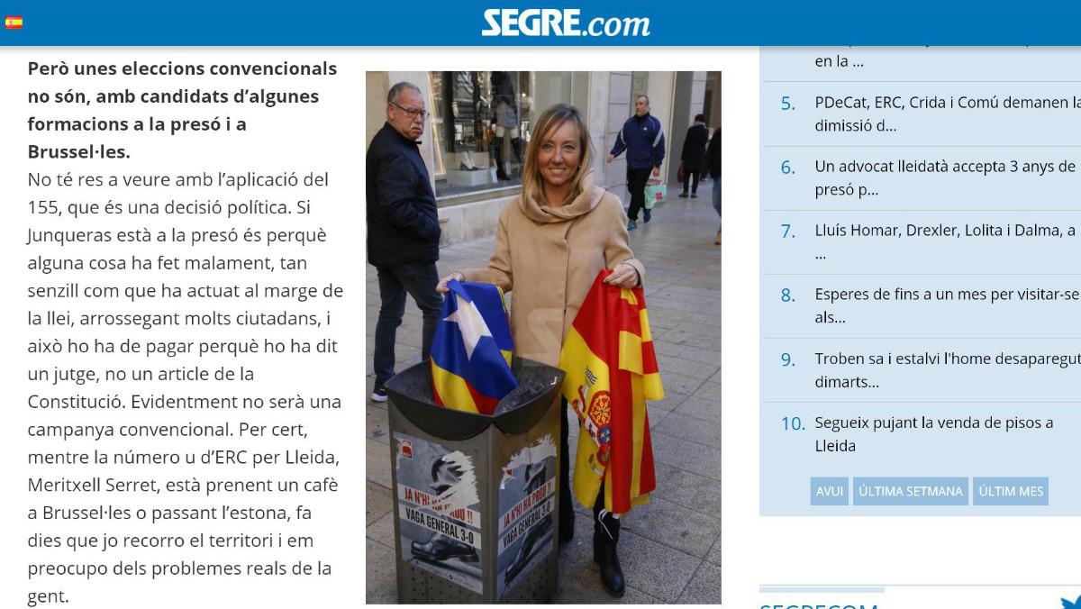 Caputra de pantalla de la entrevista en formato digital en la que la candidata por Lleida del PP, Marisa Xandri, se fotografió lanzando una estelada a la papelera.