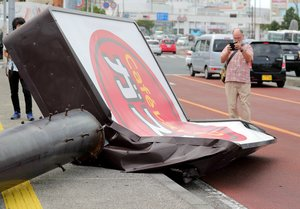 FRA01 Urasoe Japan 30 09 2018 - A restaurant signboard is seen collapsed due to strong winds generated by typhoon Trami in Urasoe southern island of Okinawa Japan 30 September 2018 After injuring 40 people in Okinawa the powerful typhoon is moving north across Japan The Japan Meteorological Agency is warning about landslides and floods Transportation services are largely disrupted across the country Bullet train services in western and central Japan are suspended and the Kansai International Airport is shut down Japan Railway announced it will stop all train service in the Tokyo area from 8pm as typhoon Trami is approaching Inundaciones Japon Tokio EFE EPA JIJI PRESS JAPAN OUT EDITORIAL USE ONLY NO ARCHIVES