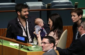 New Zealand Prime Minister Jacinda Ardern holds her baby before speaking at the Nelson Mandela Peace Summit during the 73rd United Nations General Assembly in New York U S September 24 2018 REUTERS Carlo Allegri