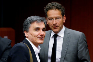 FILE PHOTO: Greek Finance Minister Euclid Tsakalotos and Eurogroup President Jeroen Dijsselbloem attend an extraordinary meeting of euro zone finance ministers in Brussels