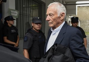 Former Ford Motor Co  executive Pedro Muller leaves a courthouse after he was sentenced to 10 years for crimes against humanity committed against 24 Argentine union workers during the country s 1976-1983 military dictatorship  in Buenos Aires  Argentina.  AP Photo Gustavo Garello
