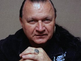 ADVANCE FOR WEEKEND EDITIONS, JULY 18-20--Dick Dale, king of the surf guitar, poses for a portrait in his New York hotel room June 2, 1997. At age 60, Dale has just released an album, Better Shred Than Dead: The Dick Dale Anthology, just in time for the summer surf season. (AP Photo/Rick Maiman)