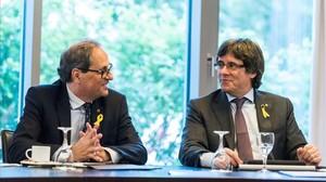Elpresident de la Generalitat, Quim Torra, y el expresidente Carles Puigdemont, en un encuentro en Berlín el pasado junio.