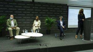 Una de las sesiones del Women Evolution, este jueves, en Sant Cugat. A la izquierda, Albert Sáez, director de EL PERIÓDICO.
