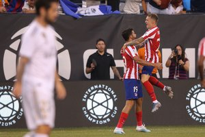 Jul 26 2019 East Rutherford NJ USA Atletico de Madrid forward Diego Costa 19 celebrates after scoring a goal against Real Madrid with defender Kieran Trippier 23 during the first half of an International Champions Cup soccer series match at MetLife Stadium Mandatory Credit Brad Penner-USA TODAY Sports