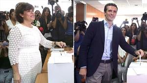 Soraya Sáenz de Santamaría y Pablo Casado, en el momento de depositar sus respectivos votos.