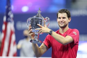 NEW YORK, NEW YORK - SEPTEMBER 13: Dominic Thiem of Austria celebrates with championship trophy after winning in a tie-breaker during his Men's Singles final match against Alexander Zverev of Germany on Day Fourteen of the 2020 US Open at the USTA Billie Jean King National Tennis Center on September 13, 2020 in the Queens borough of New York City. Matthew Stockman/Getty Images/AFP