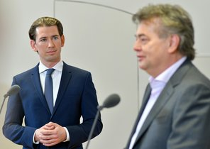 01 January 2020, Austria, Vienna: Sebastian Kurz (L), leader of the Austrian People's Party (OeVP) and Werner Kogler, leader of The Greens, hold a joint press conference at the Winter Palace of Prince Eugene after reaching a coalition deal. Photo: Herbert Neubauer/APA/dpa