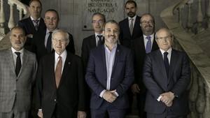 Jaume Collboni, flanqueado a la izquierda por Miquel Valls, y a la derecha, por José Montilla.