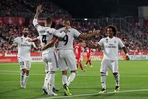 Soccer Football - La Liga Santander - Girona v Real Madrid - Montilivi Girona Spain - August 26 2018 Real Madrid s Karim Benzema celebrates scoring their second goal with teammates REUTERS Albert Gea