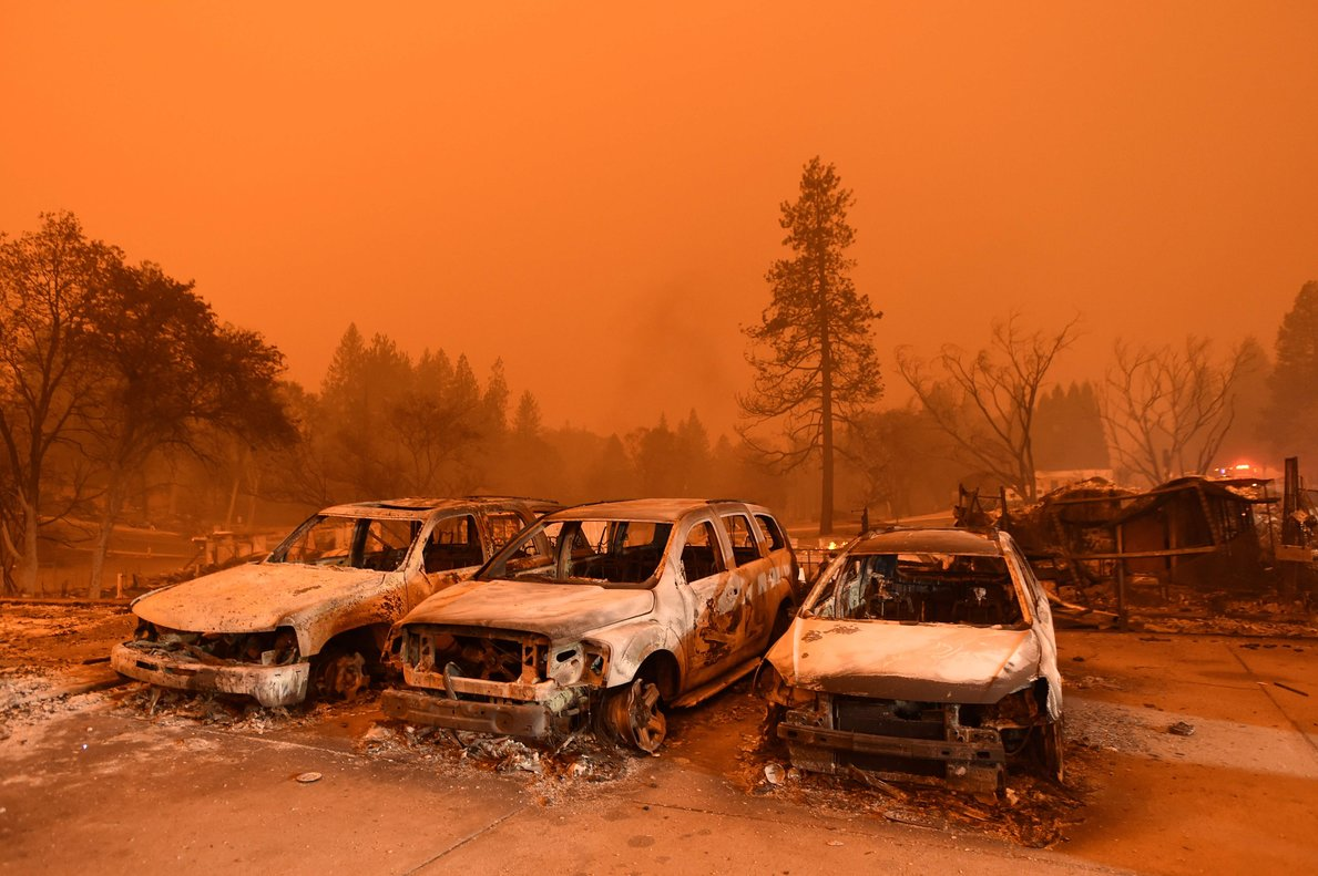 TOPSHOT - Abandoned vehicles sit at a car lot in Paradise, north of Sacramento, California on November 09, 2018. - A rapidly spreading, late-season wildfire in northern California has burned 20,000 acres of land and prompted authorities to issue evacuation orders for thousands of people. As many as 1000 homes, a hospital, a Safeway store and scores of other structures have burned in the area as the Camp fire tore through the region. (Photo by Josh Edelson / AFP)
