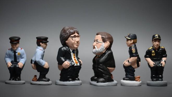 Caganers de Josep Lluís Trapero,Carles Puigdemont,Mariano Rajoy y un agente de la Policía Nacional.