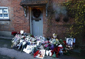 Tributes are seen outside the house of singer George Michael, where he died on Christmas Day, in Goring, southern England, Britain December 26, 2016. REUTERS/Eddie Keogh