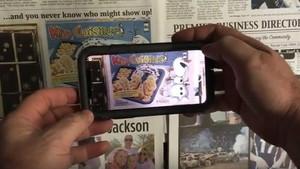 Una app permite ver los contenidos multimedia acercando el móvil a unos códigos que aparecen en la versión impresa del diario