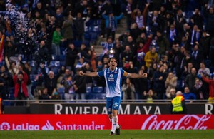 Espanyols midfielder Victor Sanchez celebrates his teams opening goal during the Spanish league football match RCD Espanyol vs Villarreal CF on February 18, 2018 at the Cornella-El Prat stadium in Cornella. / AFP PHOTO / Josep LAGO