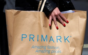 FILE PHOTO A shopper walks past a branch of clothing retailer Primark in London Britain April 27 2013 REUTERS Suzanne Plunkett File Photo
