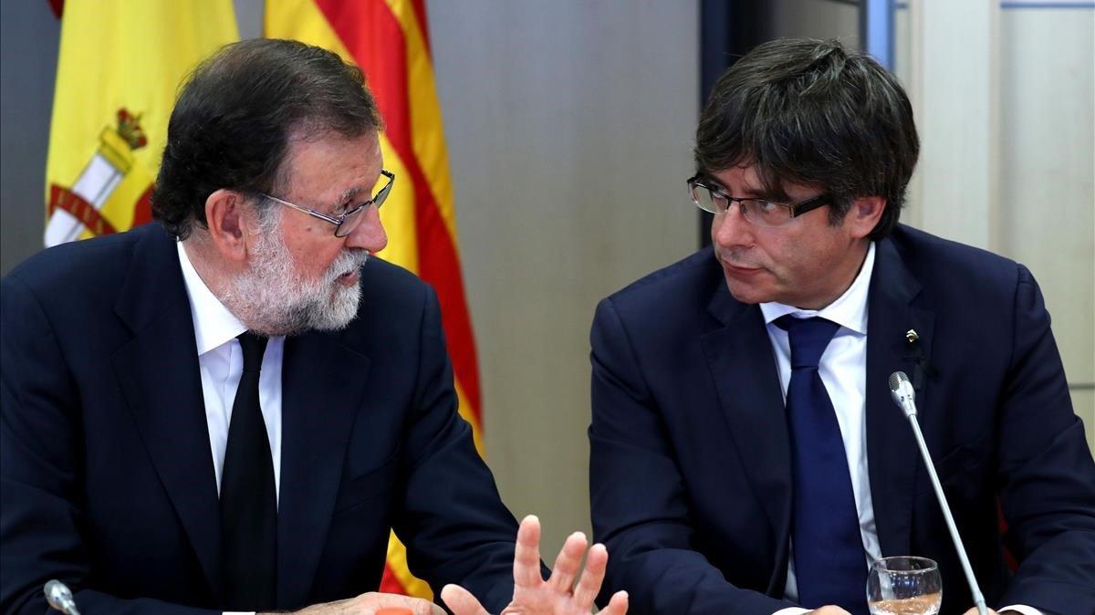 Rajoy y Puigdemont, en el 2017.