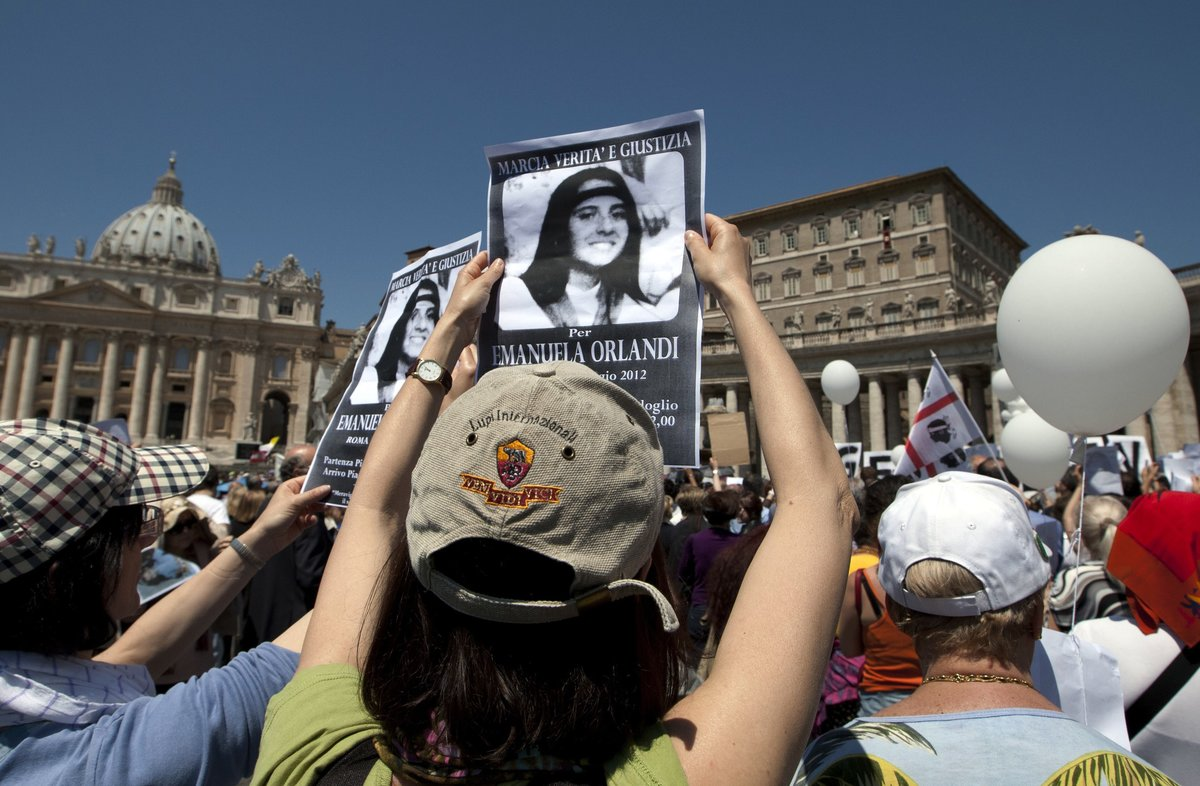 Demonstrators hold pictures of Emanuela Orlandi readingmarch for truth and justice for Emanueladuring Pope Benedict XVI s Regina Coeli prayer in StPeter s squareat the VaticanThe Vatican says human bones were found during renovation work near its embassy to Italyreviving speculation once again about the fate of Orlandithe 15-year-old daughter of a Vatican employee who disappeared in 1983AP Photo Andrew MedichiniFile