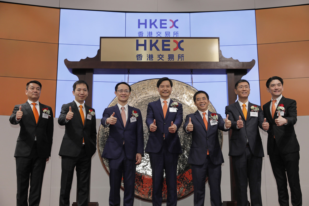 From Left to right, Xiaomi's Co-Founders, Wang Chuan, Hong Feng, Lin Bin, Lei Jun, Li Wanqiang, Liu De, Wong Kong Kat, pose for pictures during the listing ceremony at the Hong Kong Stock Exchange in Hong Kong Monday, July 9, 2018. Chinese smartphone maker Xiaomi Corp. shares have slipped in its first trading day in Hong Kong following a multibillion-dollar initial public offering. (AP Photo/Vincent Yu)