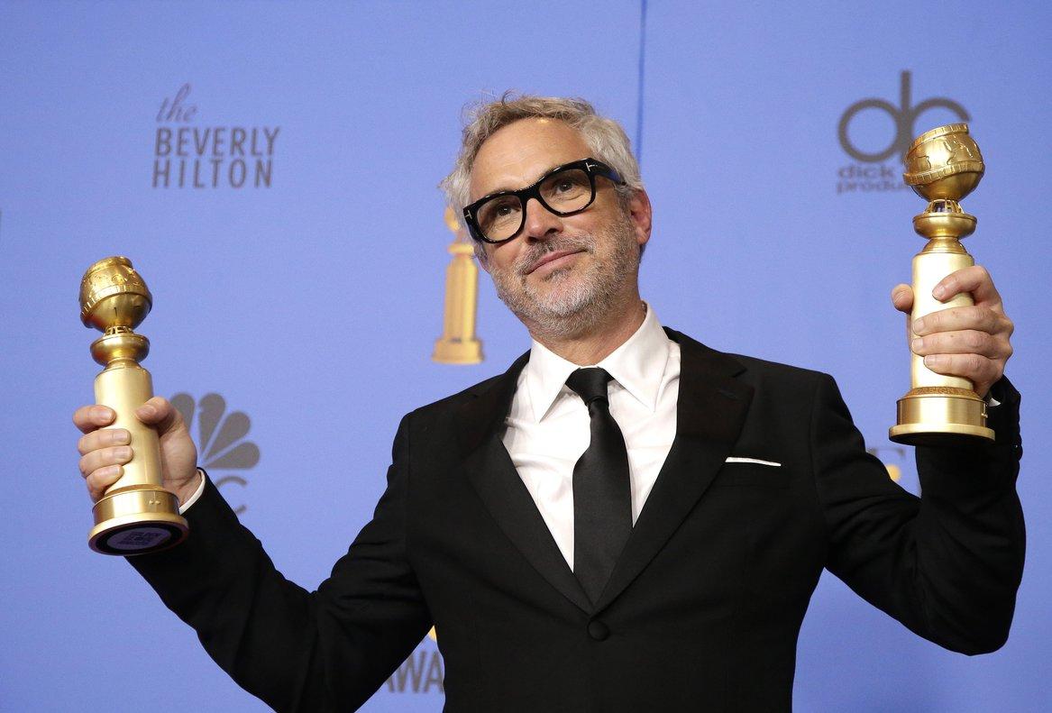 Alfonso Cuarón gana como mejor director en los Globos de Oro 2019 por Roma.