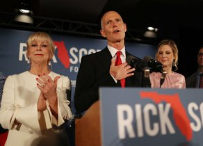 Florida Governor Rick Scott speaks as he stands with his wife  Ann Scott   and daughter Alison Guimard  R  during his election night party at the LaPlaya Beach   Golf Resort in Naples  Florida  -  Photo by JOE RAEDLE   GETT