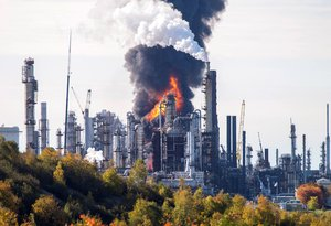 Flames are visible at the scene of a major explosion and fire at the Irving oil refinery in Saint JohnNew BrunswickCanadaOctober 82018REUTERS Michael Hawkins