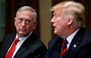 FILE PHOTO U S Defense Secretary James Mattis listens as U S President Donald Trump speaks to the news media while gathering for a briefing from his senior military leaders in the Cabinet Room at the White House in Washington U S October 23 2018 REUTERS Leah Millis File Photo