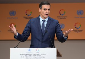 Spanish Prime Minister Pedro Sanchez addresses the United Nations conference on migration on December 10 2018 in the Moroccan city of Marrakesh - Politicians from around the globe gathered in Morocco for a major conference to endorse a United Nations migration pact despite a string of withdrawals driven by anti-immigrant populism The Global Compact for Safe Orderly and Regular Migration was finalised at the UN in July after 18 months of talks and is due to be formally adopted with the bang of a gavel at the start of the two-day conference in Marrakesh Photo by FETHI BELAID AFP