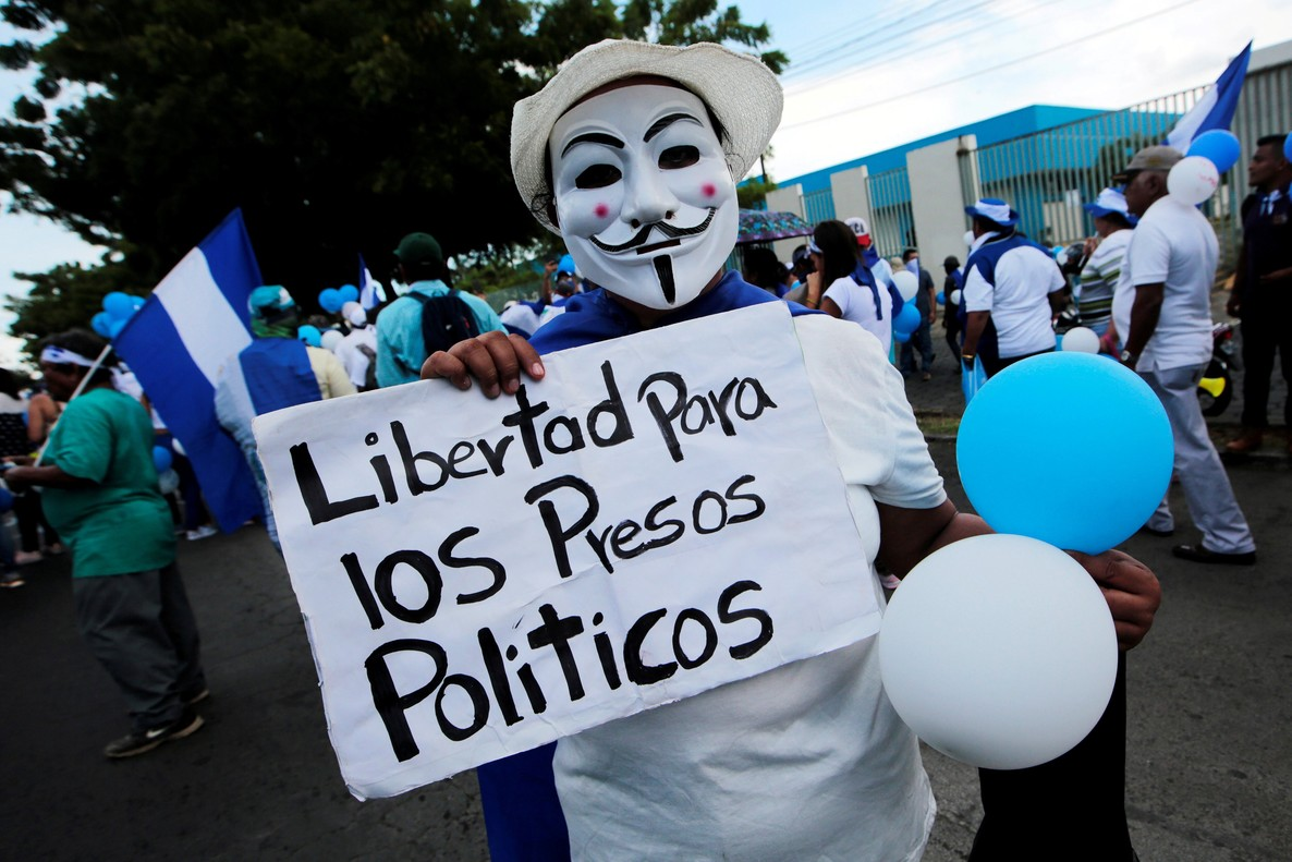A masked anti-government protester takes part in a march called March of the balloons in Managua Nicaragua September 9 2018 The signal reads Freedom for political prisoners REUTERS Oswaldo Rivas