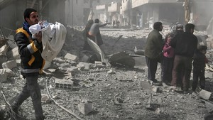 zentauroepp42204667 a syrian man carries an infant rescued from the rubble of bu180219191651