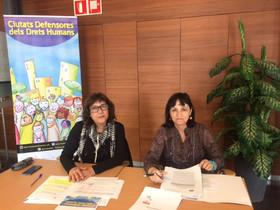Ledil Marisa Merchán iDolors Fernández en la presentaciódel projecte Ciutats Defensores dels Drets Humans.